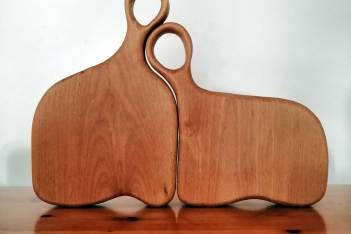 Happy couple chopping board