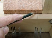 Lines drawn on cradle to locate cut