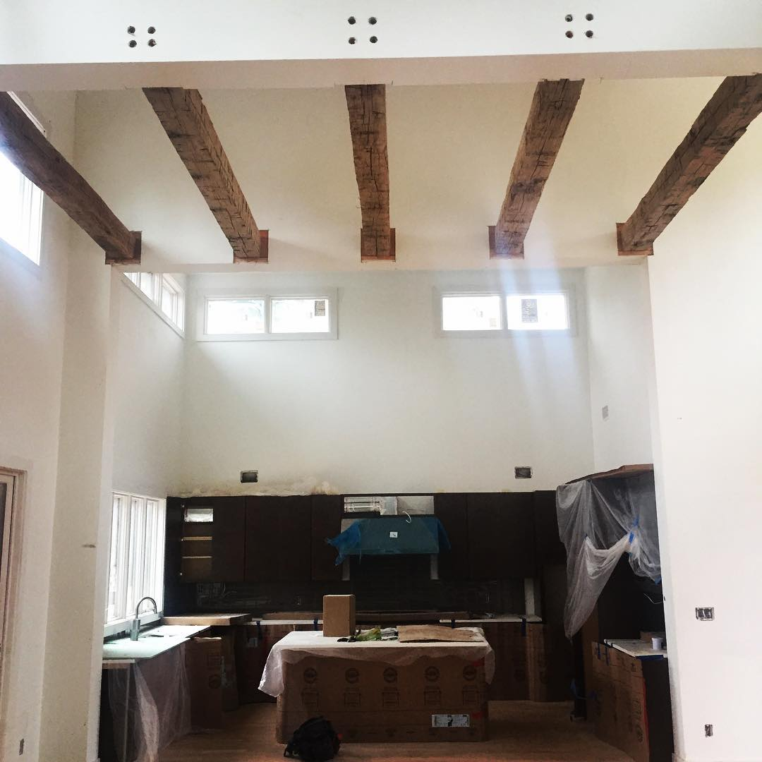 @woodworx_extreme_carpentry we install this 5 hand hewn beams in a Davidson home, super heavy