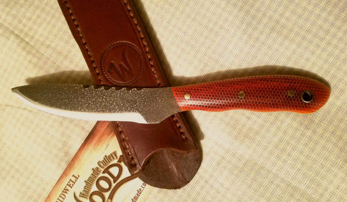 """A custom knife with handle material """"orange honey comb"""""""