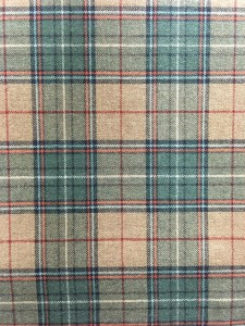 Swatch of Pendleton fabric with a plaid of green, red and white on a tan mix background.