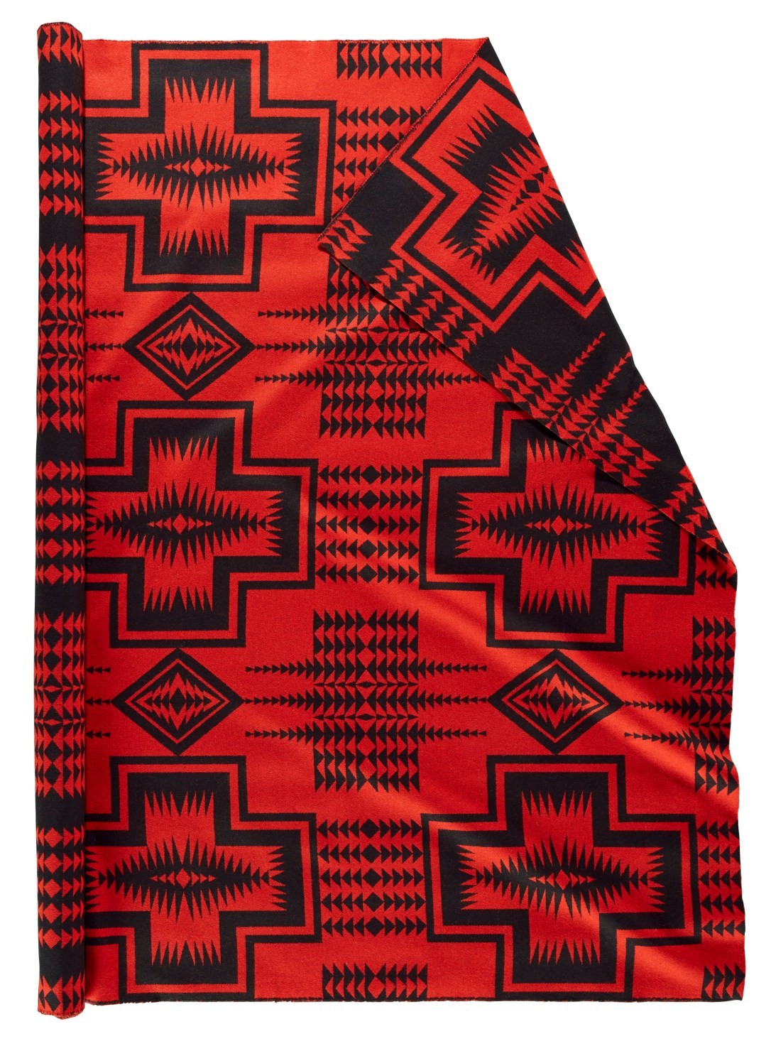 A roll of Pendleton wool fabric in Walking Rock, red, which is a bold red backgrowund with a pattern in black of crosses and chains of arrows.