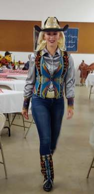 Miss Rodeo Oregon 2019, Taylor Ann Skramstad, wears jeans, a silver satin shirt, and a vest and western boots embellished wit Pendleton wool.