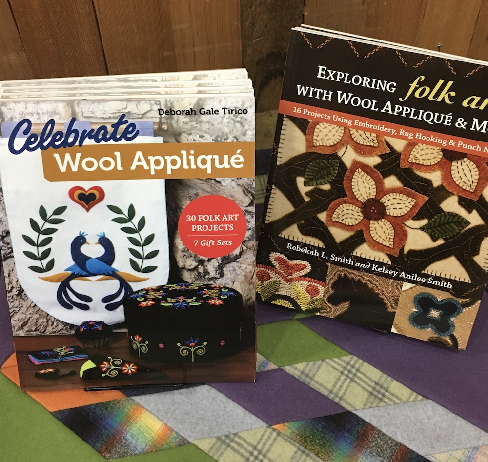 Two craft books about wool applique.