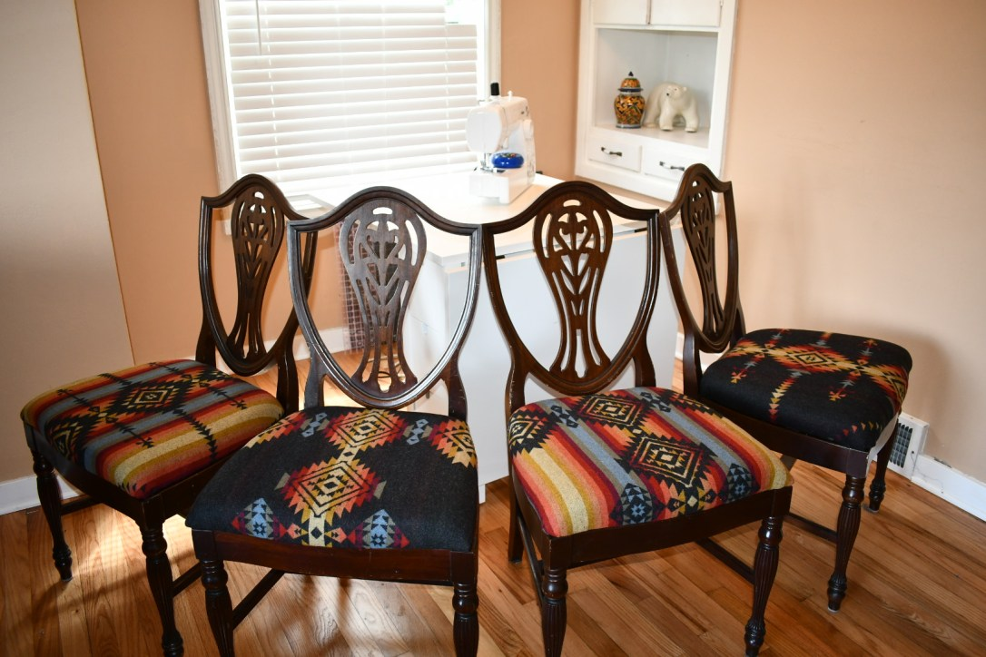 Four traditional wooden dining chairs, recovered in Pendleton Pueblo Dwelling wool fabric.