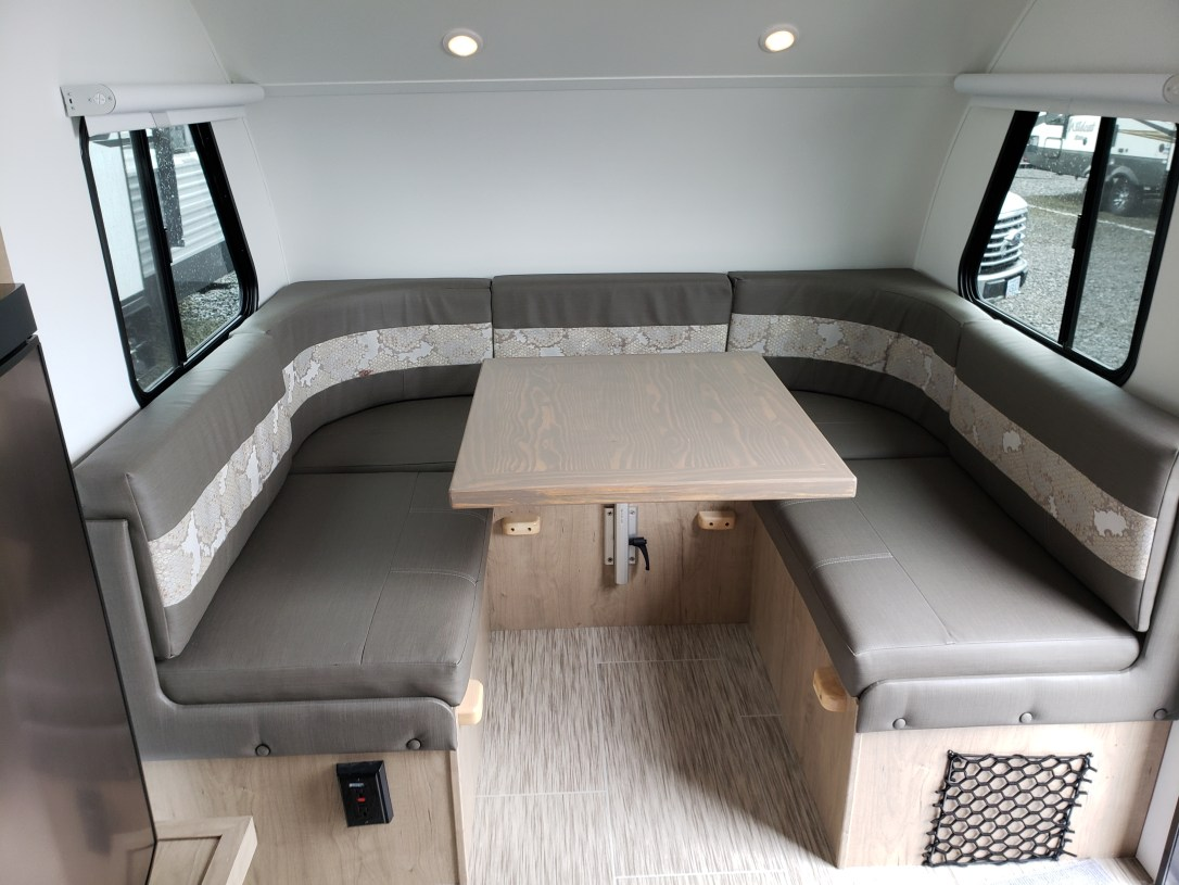 A U-shaped eating area in a camper.