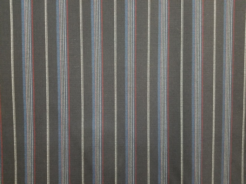 Striped fabric, narrow red, white, yellow on a navy ground