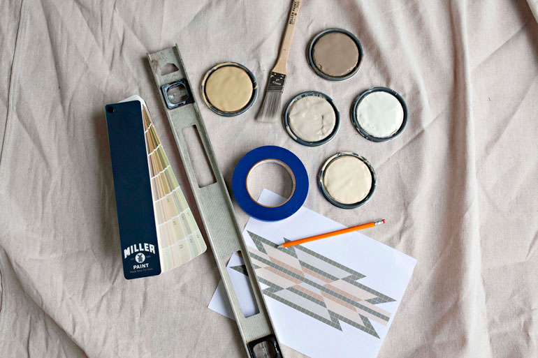 Cans of paint and painting tools on a drop cloth. Photo by Oregon Home magazine, used with permission.