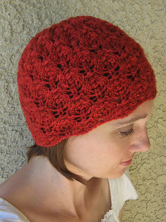 http://www.ravelry.com/patterns/library/flower-bud-beanie
