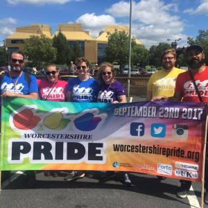 TOGETHER: Dr Daniel Somerville (far left) with the Worcestershire Pride banner.