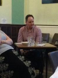 Tim listens intently