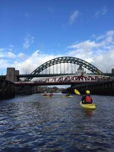 Kakaks paddling beneath the High Level Bridge on the Tyne