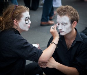 street performers doing each others make up