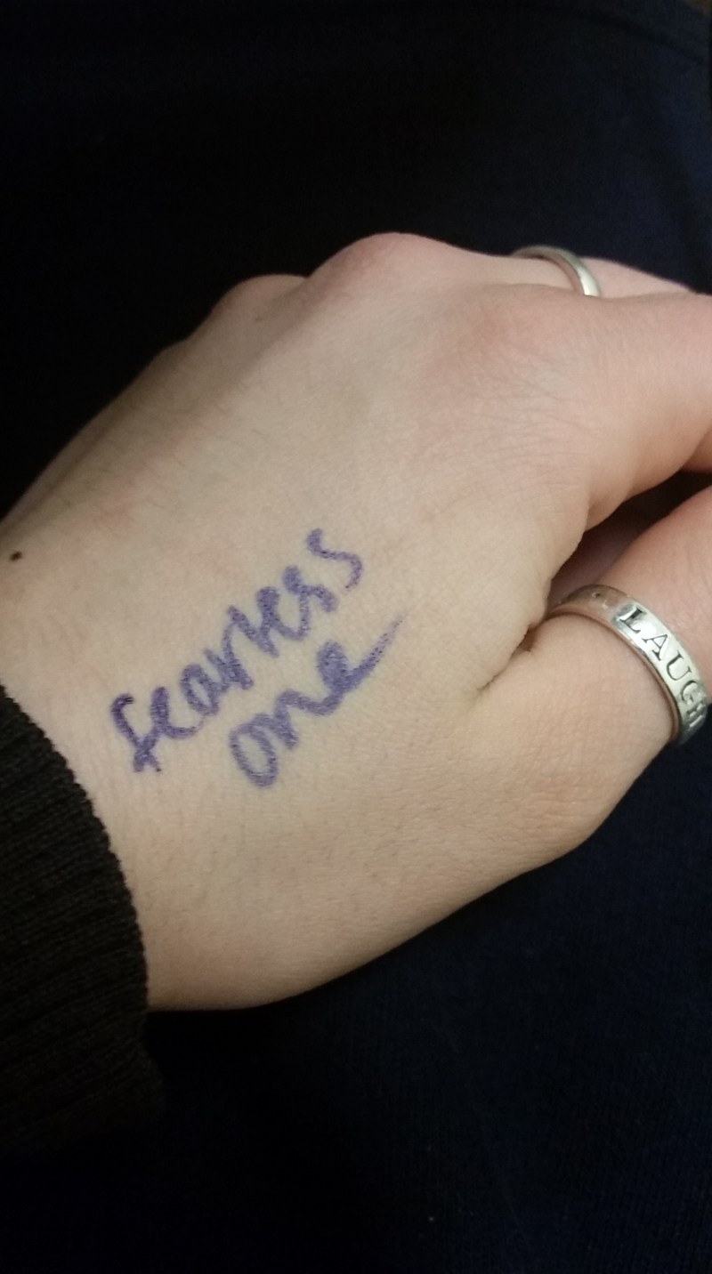 hand with words 'fearless one' on them