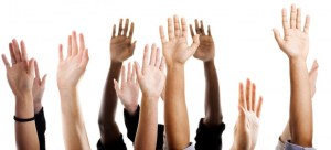 Hands of diverse people raised