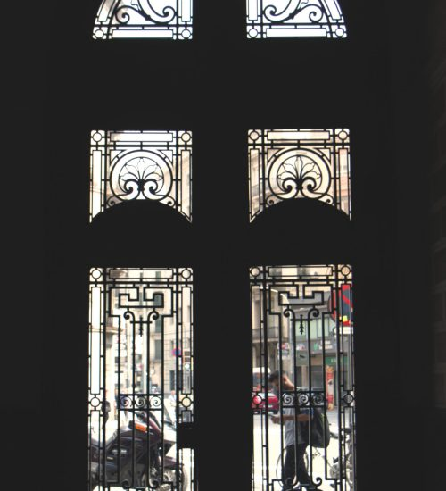 entry doors with man walking outside
