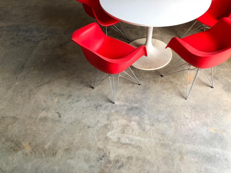Photo of red chairs at a white table