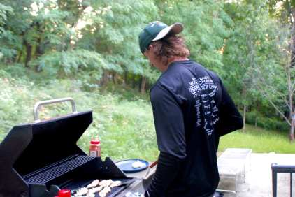 Neighbor, Austin Dambach, going to work on the grill on Sept. 20, 2020. He loves to cook, especially grill, but sometimes the food doesn't come out too good.