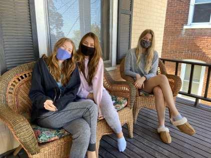 Caitlyn Devine '22, Cassie McCabe '22, and Emmaline Kremsky '22 sit on their doorstop off-campus at Lehigh University Sept. 20 2020. (Kate Brady)