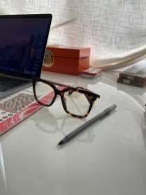 Catherine Begier keeps her blue light glasses on her desk to protect her from the harmful exposure in Radnor, PA on Sunday, Sept. 27, 2020. Catherine bought them to use while she works on her laptop all day. (J24/Grayson Begier)