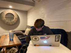 Bo Brady gets back to his laptop to log into class after his break is over on Sept 15 2020 in Merrick, NY. Brady doesn't mind his online days since he gets to stay on the couch. (Kate Brady/J24)