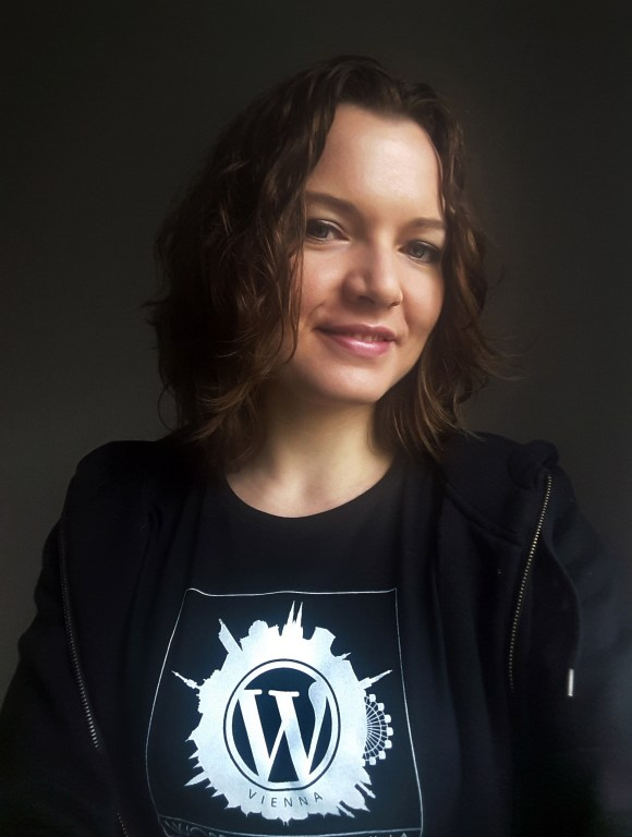 Olga with a WordCamp Vienna t-shirt