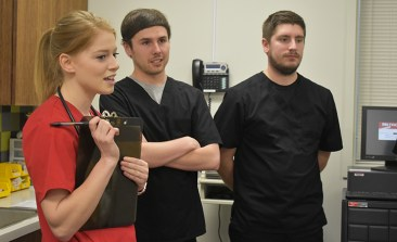 A U of A nursing student, left, answers questions for the UAMS physical therapy students.