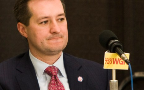 Tom Ricketts answers questions at a press conference.