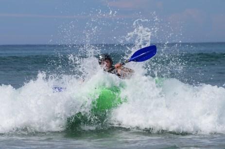 Nick surf kayaking, tipping