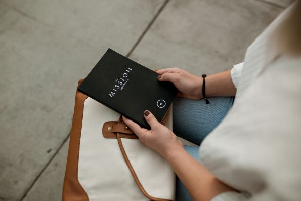 woman holding journal