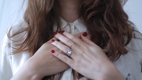 woman hands on heart