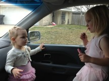 Putting on lipgloss before ballet