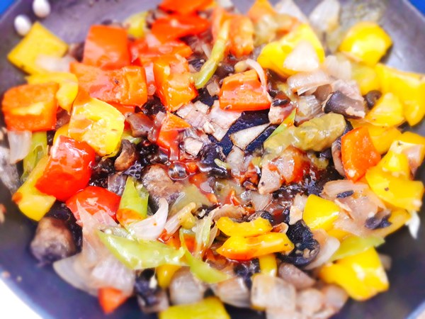 Stir fry till translucent or pink. Now add the peppers and keep stirring.