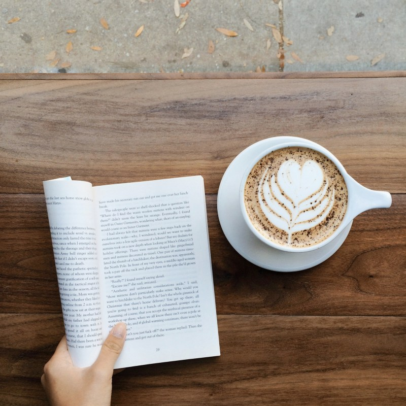 flatlay with book and coffee on table