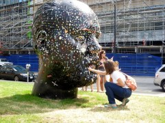 Adding my piece of SkyTrain defence gum to the Gumhead outside the Gallery.