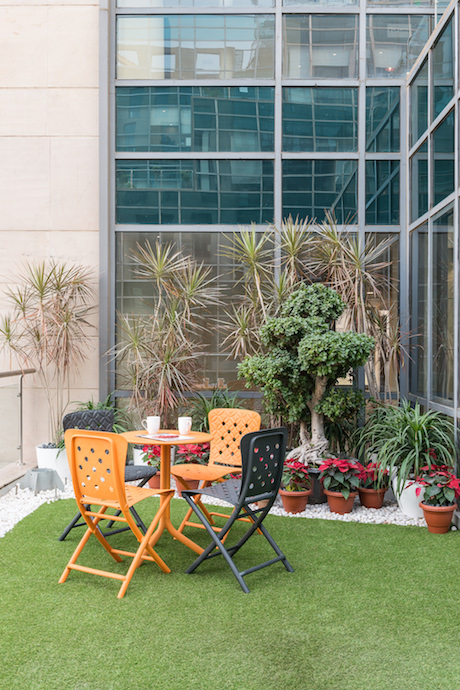 The terrace garden gives the workforce their necessary dose of fresh air and greenery. Image courtesy of PHX India.