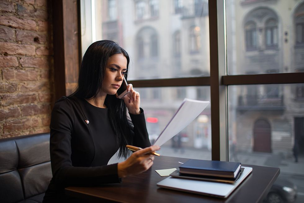 Businesswoman makes a series of networking calls.
