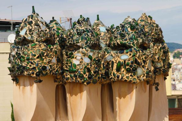 The green 'mosaics' is actually broken champagne bottles!