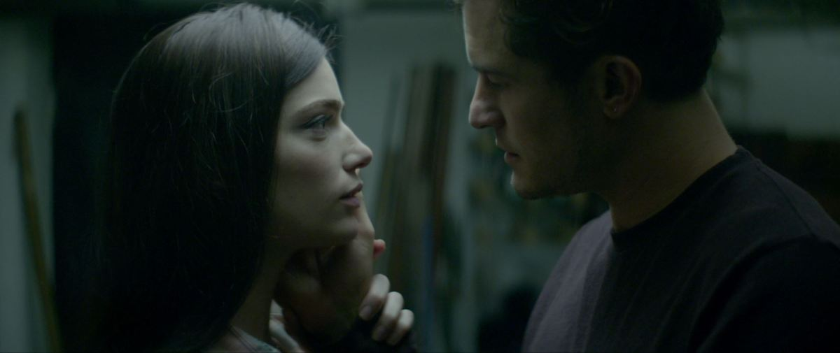 Janet Montgomery and Orlando Bloom in Retaliation (2020 US).