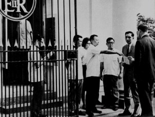 Chau Yick/Zhou Yi is pictured six from right, behind the gate, outside the Government House in 1967