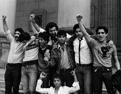 Bradford 12 defendants celebrate victory. Standing L-R: Tariq Mehmood, Giovani Sigh (deceased), then Vasant Pate (deceased), Saeed Hussain (Deceased), Brahm Khan, Ahmed Malik, Saber Hussain; crouching: Praveen Patel