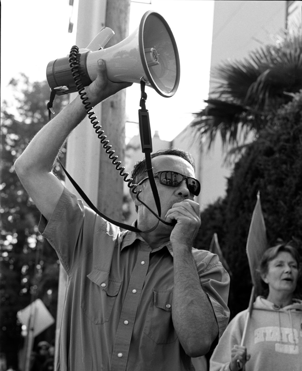 Man with megaphone at strike