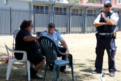 Indigenous community leader Sam chats to the police as they come to investigate the campsite.