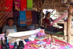 Menfolk, unadorned with tribal dress, are of little interest to tourists, and often spend their days drinking or lazing out of sight in bamboo houses while the women weave handicrafts and pose for photographs.