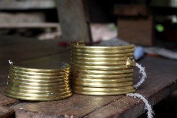 """""""Tourist rings"""" are used by the Padaung women to lure more tourists in for interesting photos, and the possibility of a tip."""