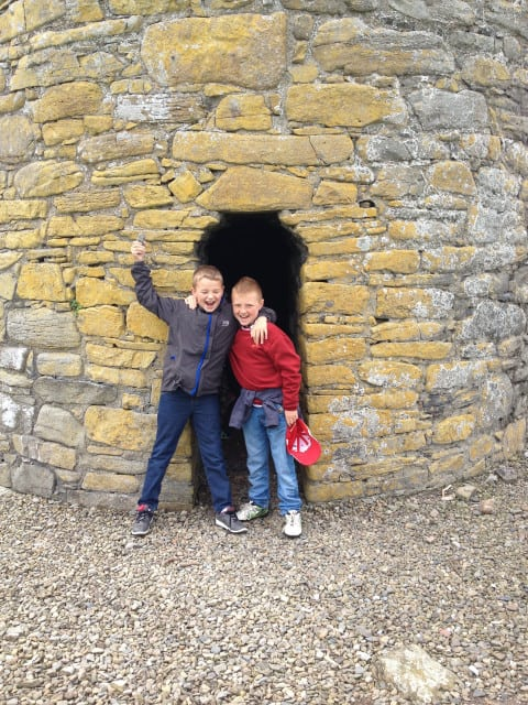 Boys at the foot of the roundtower, Scattery Island