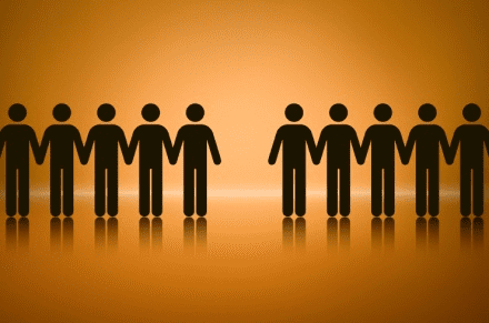 A row of black figures set against a brown background in a row with one missing in teh middle, to depict absence from work