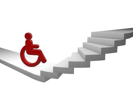 A man in a wheelchair stuck at the bottom of the stairs
