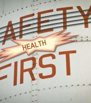An image with the word safety crossed out and replaced by the word health above the word first. This looks like the side of a big oil drum