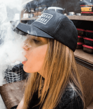 image of girl in hat vaping